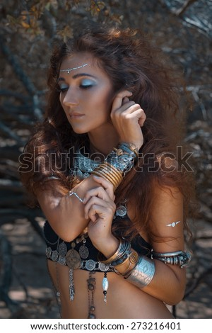 Tribal style girl in forest - stock photo