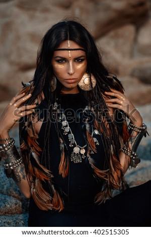 tribal woman posing outdoors - stock photo