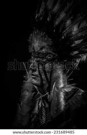 tribe Native, American Indian chief with big feather headdress - stock photo