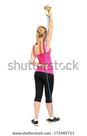 triceps extension exercise using rubber resistance band. position 2 of 2. - stock photo