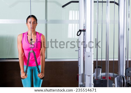 Triceps pressdown high pulley workout woman at gym exercise - stock photo
