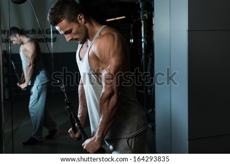 Triceps Pull down Workout - stock photo