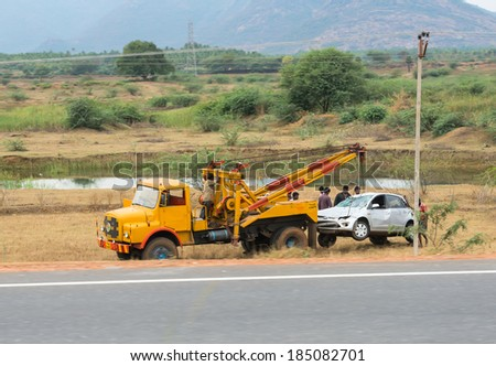 TRICHY, INDIA - FEBRUARY 15: After the accident, the car raise evacuate. India, Tamil Nadu, near Trichy. February 15, 2013 - stock photo