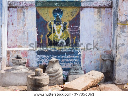 Trichy, India - October 15, 2013: Painting on shrine wall at Amma Mandapam of Lord Vishnu in royal lion avatar, called Narasimha. Seven headed cobra as background. - stock photo