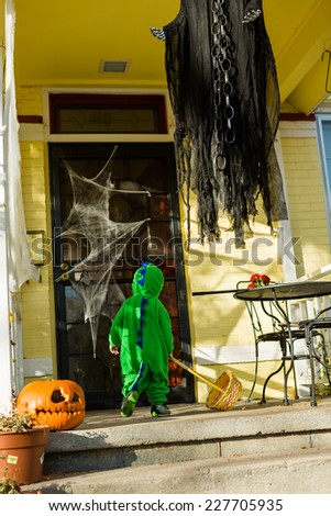 Trick or treating in costumes on Halloween night. - stock photo