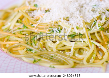 Tricolored spaghetti pasta with spinach and parmesan