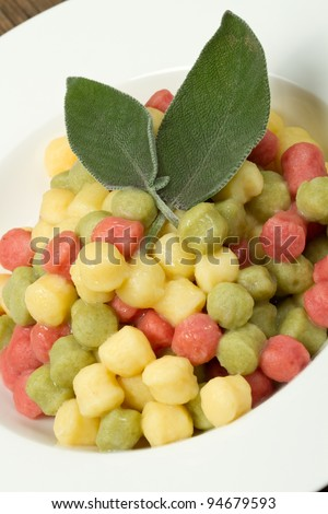 Tricolour gnocchi with melted butter sage - stock photo