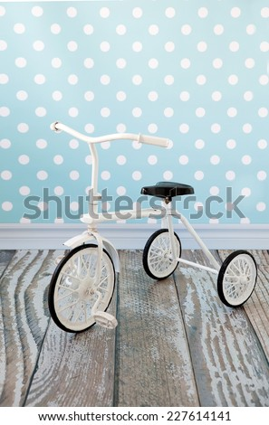 tricycle children bicycle in the interior - stock photo