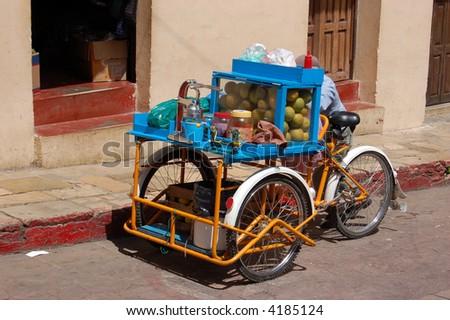 Tricycle Fruit Juice Vendor in Chiapas Mexico - stock photo