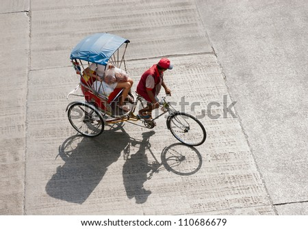 Tricycle taxi. - stock photo