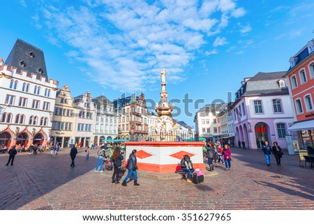 TRIER, GERMANY - NOVEMBER 05, 2015: main market square in Trier with unidentified people. It lies in the historical city center with a lot of old buildings from renaissance, baroque and classicism - stock photo