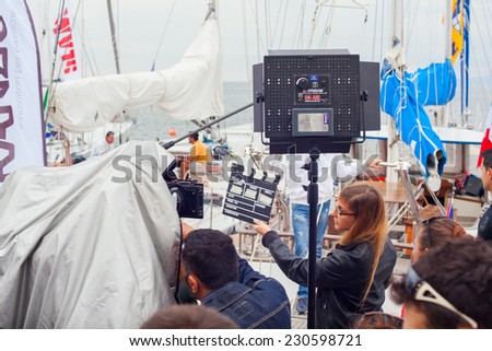 TRIESTE, ITALY - OCTOBER, 12: Girl holding clapperboard during the production of short film on October 12, 2014 - stock photo