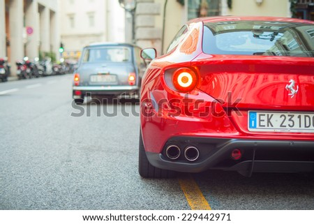 TRIESTE, ITALY - OCTOBER, 04: View of red Ferrari FF in the Trieste street on October 04, 2014 - stock photo