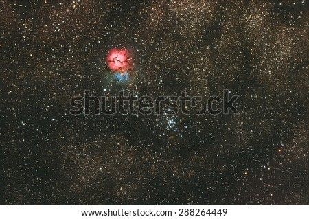 Trifid Nebula with Galaxy,Open Cluster, stars and space dust in the universe long expose. - stock photo