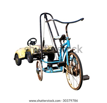 Trike with a Toy Car in Tow - stock photo