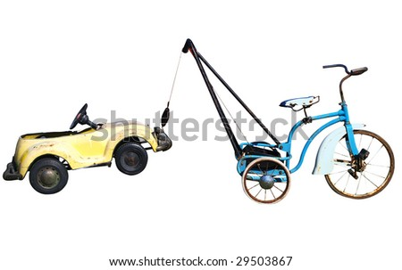 Trike with a Toy Car in Tow isolated with clipping path - stock photo