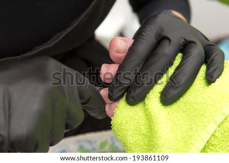 trim nails on foot cutters - stock photo