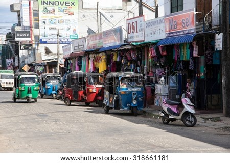 TRINCOMALEE, SRI LANKA - AUGUST 28, 2015: Tuk-tuks are a common way of transport in Sri Lanka and many other asian countries