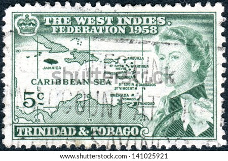 TRINIDAD AND TOBAGO - CIRCA 1958: A postage stamp printed in Trinidad and Tobago, is dedicated to the formation of the West Indian Federation, shows Queen Elizabeth II and Caribbean island, circa 1958
