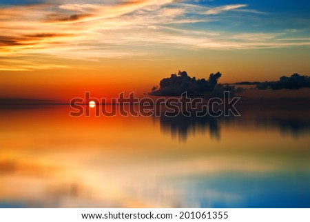 Trinidad and Tobago Sunset calm waters beautiful sky - stock photo