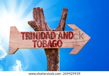 Trinidad and Tobago wooden sign with sky background - stock photo