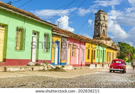 TRINIDAD, CUBA - DECEMBER 7, 2013: Colorful colonial houses on Trinidad street - stock photo