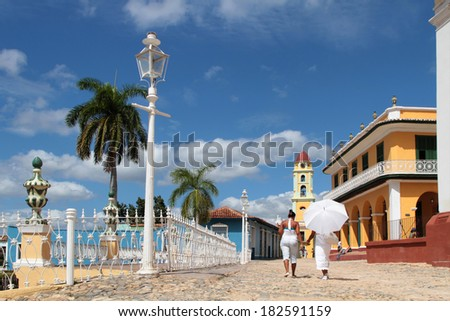 TRINIDAD, CUBA, FEBRUARY 19, 2014: Old town of Trinidad, Cuba. Trinidad is a historical town listed by UNESCO as World Heritage, it is full of colonial buildings and main tourist spot. - stock photo