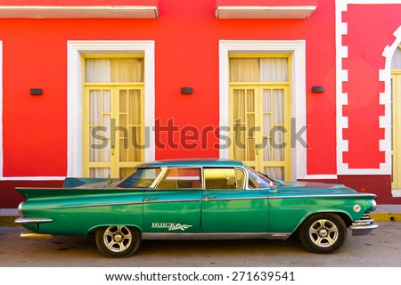 Trinidad, CUBA - JANUARY 19, 2014: Old classic American car Trinidad,CUBA. Before a new law issued IN 2011, Cubans could only trade old cars that were on the road before the revolution of 1959 - stock photo