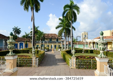 Trinidad, Cuba - 9 january 2016: people walking on the streets with colorful traditional houses in the colonial town of Trinidad in Cuba