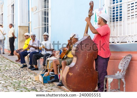TRINIDAD,CUBA-JULY 22,2014: Cuban traditional music or son street performers in exchange for tourists tips. Trinidad in a UNESCO world heritage site and a major tourist landmark in Cuba - stock photo