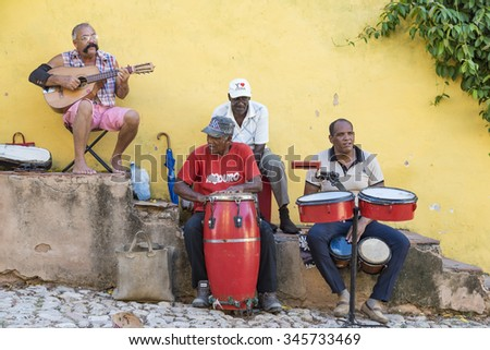 TRINIDAD,CUBA-JULY 5,2015:Trinidad scenes:Traditional musicians playing Son cubano music for the tourists.Trinidad is one of the oldest villages founded by Spanish and a UNESCO World Heritage Site  - stock photo