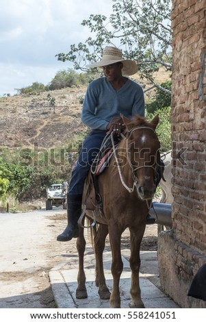 Trinidad - Cuba, March 2015: A young man rides with horse on the streets of Trinidad
