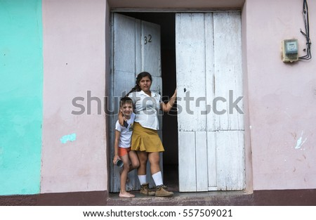 Trinidad - Cuba, March 2015; Sister and brother leaving from house