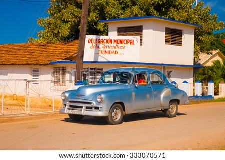 TRINIDAD, CUBA - SEPTEMBER 8, 2015: Classic Old American cars used for transportation and tourism services due to embargo. - stock photo