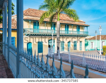 Trinidad de Cuba, colonial houses in main plaza. The village is a Unesco World Heritage and major tourist landmark in the Caribbean Island - stock photo