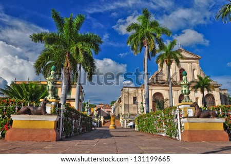 Trinidad is a town in Cuba. 500-year-old city with Spanish colonial architecture is UNESCO World Heritage site. Trinidad is famous for cobblestone streets, pastel houses with wrought-iron grills. - stock photo