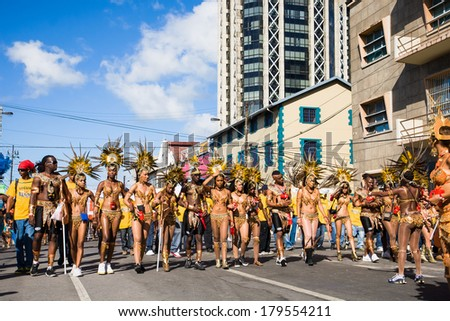 TRINIDAD WEST INDIES - FEBRUARY 5: a band of masqueraders get ready to take part in Carnival Tuesday celebrations on February 5, 2008 in Port Of Spain, Trinidad W.I. - stock photo