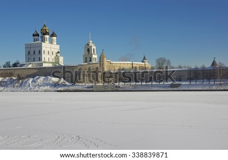 Trinity Cathedral in Pskov Kremlin, Russia across the frozen river - stock photo