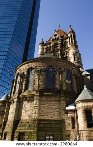 Trinity church and Hancock tower as two famous Boston landmarks in Back Bay - stock photo