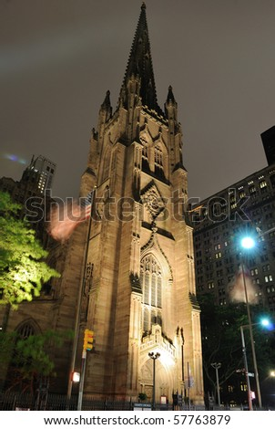 Trinity Church and its steeple at night in New York City. - stock photo