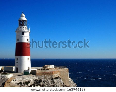 Trinity Lighthouse at Europa Point, marking the meeting point of the Mediterranean Sea and the Atlantic Ocean, in Gibraltar - stock photo