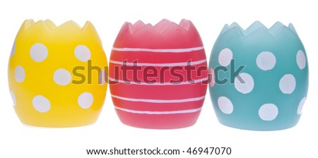 Trio of bright patterned easter eggs isolated on white with a clipping path.