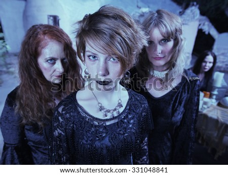 Trio of female adults in Wicca ceremony outdoors