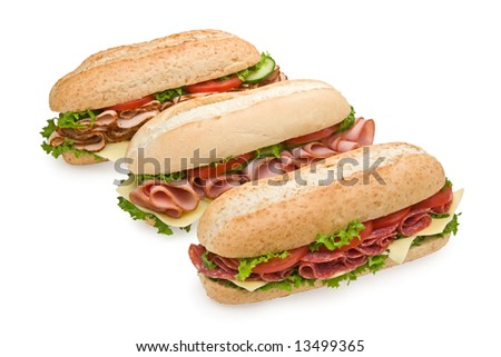 Trio of fresh sandwiches on white background - salami, ham and turkey