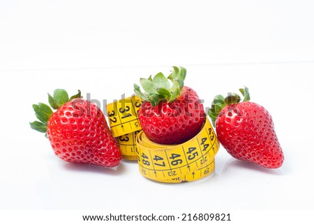 trio of strawberries and measuring tape