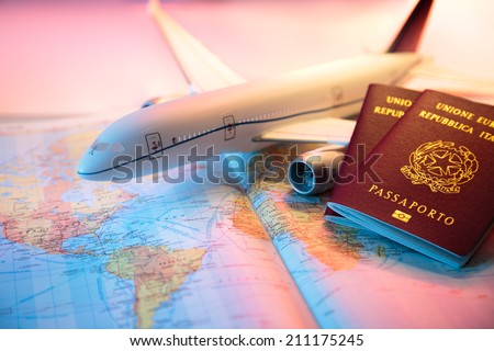 trip in America - passport, airplane and map of world  - stock photo