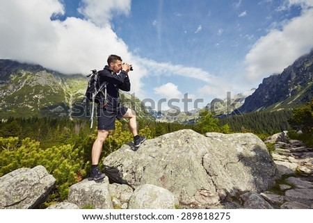 Trip of young photographer in the mountains - stock photo