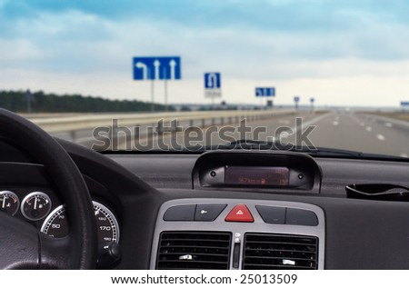 Trip on the car on dry asphalt road - stock photo