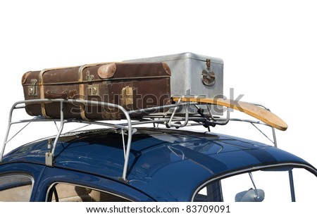 trip with car packed with luggage and ski on top of the roof - stock photo