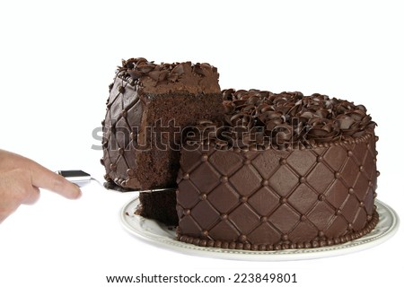 Triple Chocolate Cake with frosting roses being served sliced from the cake Isolated on white background. - stock photo